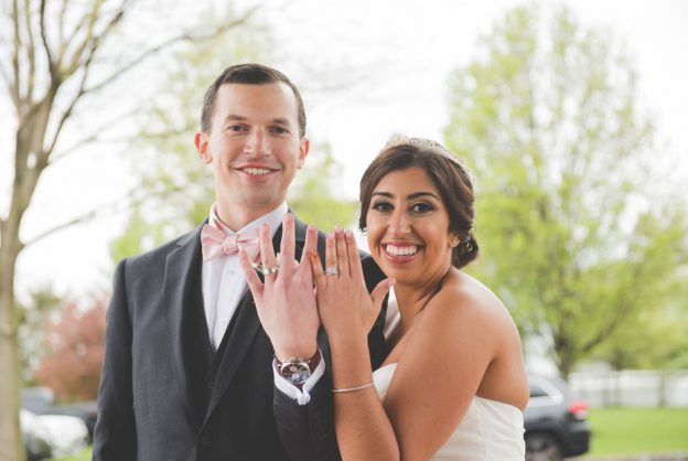 Bride and groom show off their rings at Normandy Farm Wedding