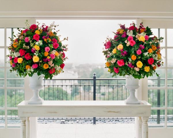 Round floral decor for wedding ceremony pink yellow green orange at DC Hay Adams