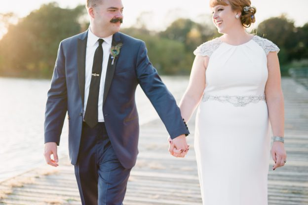 Molly and Nate holding hands at their American Swedish Historical Museum Wedding