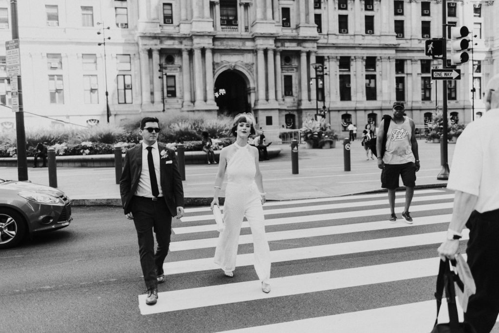 Bride in white jumpsuit City Hall Philadelphia Wedding