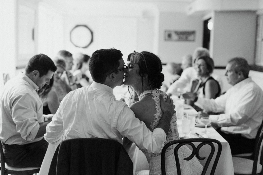 Bride and Groom at Philadelphia Restaurants eating at reception