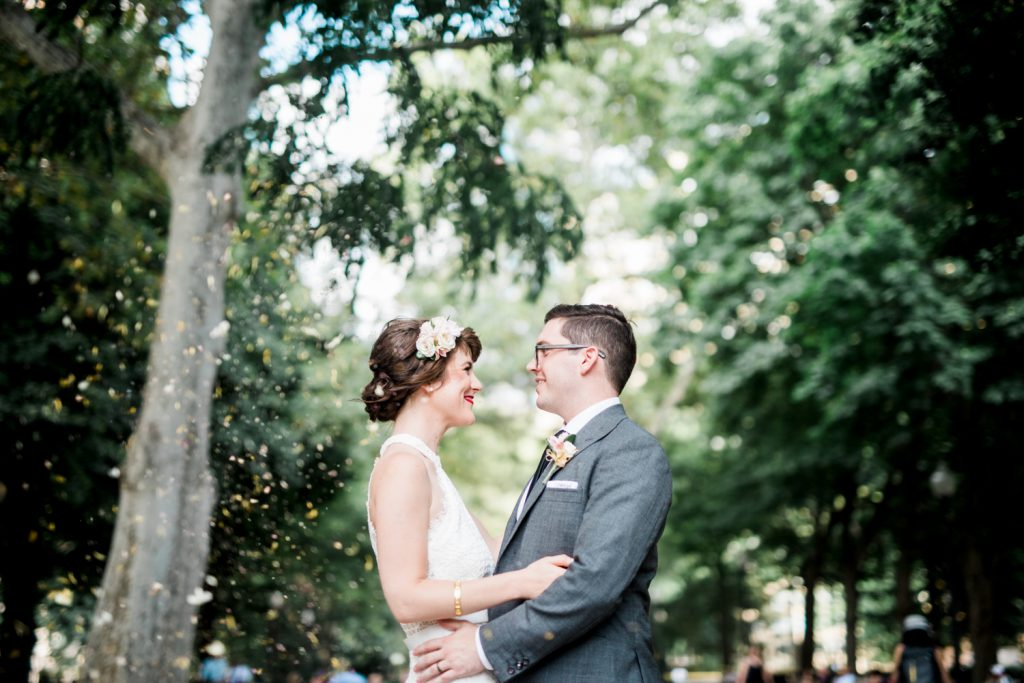 Mary and Matt embrace outside of their Philadelphia City Hall Wedding