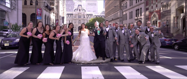 Wedding party poses on Broad Street during National Constitution Center Wedding