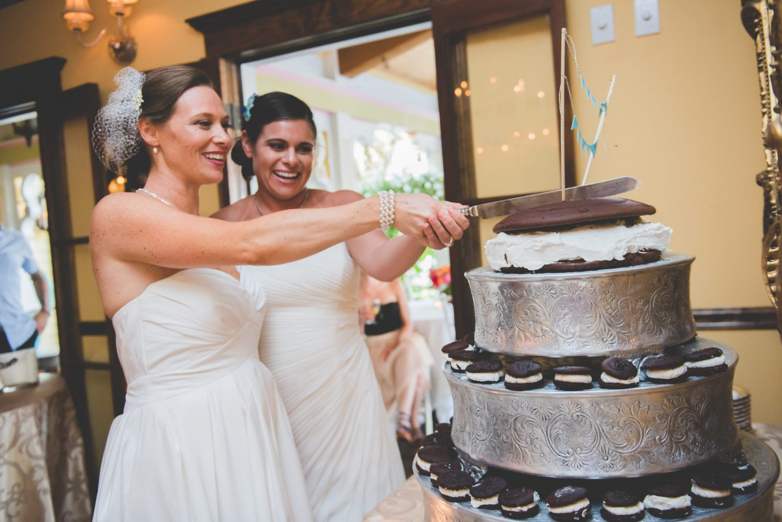 Brides cutting whoopie pie