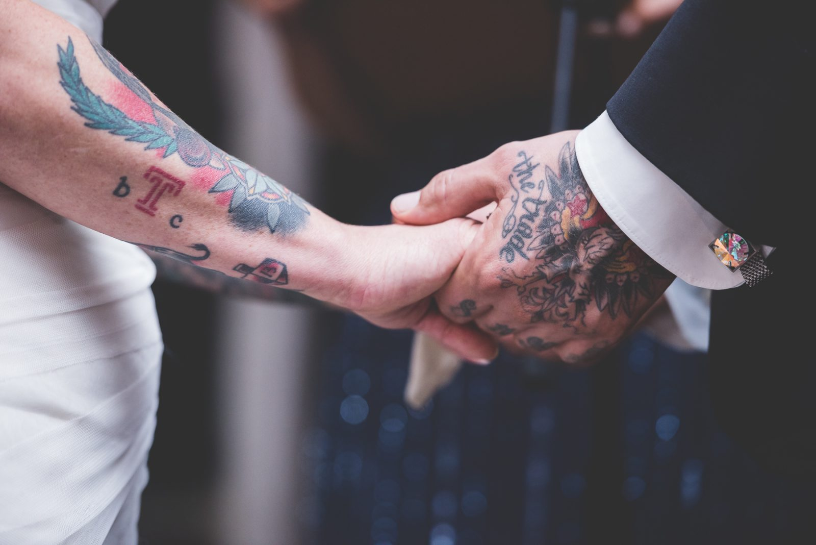 springton manor farm wedding tattooed bride and groom hands