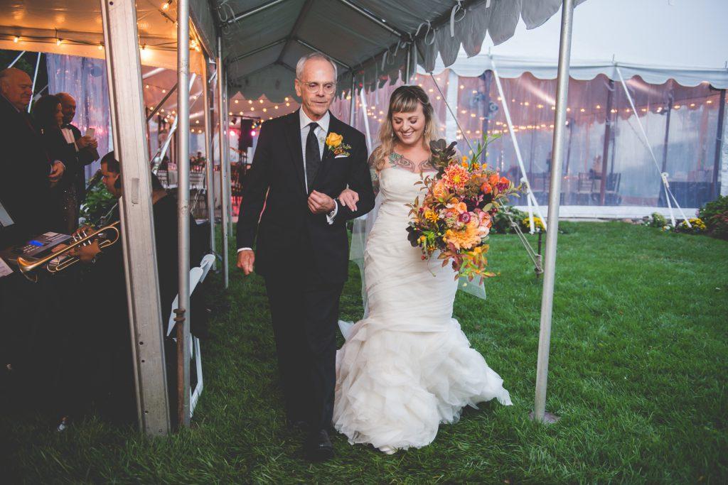 bride and groom walk down the aisle at springton manor farm wedding captured by BG Productions