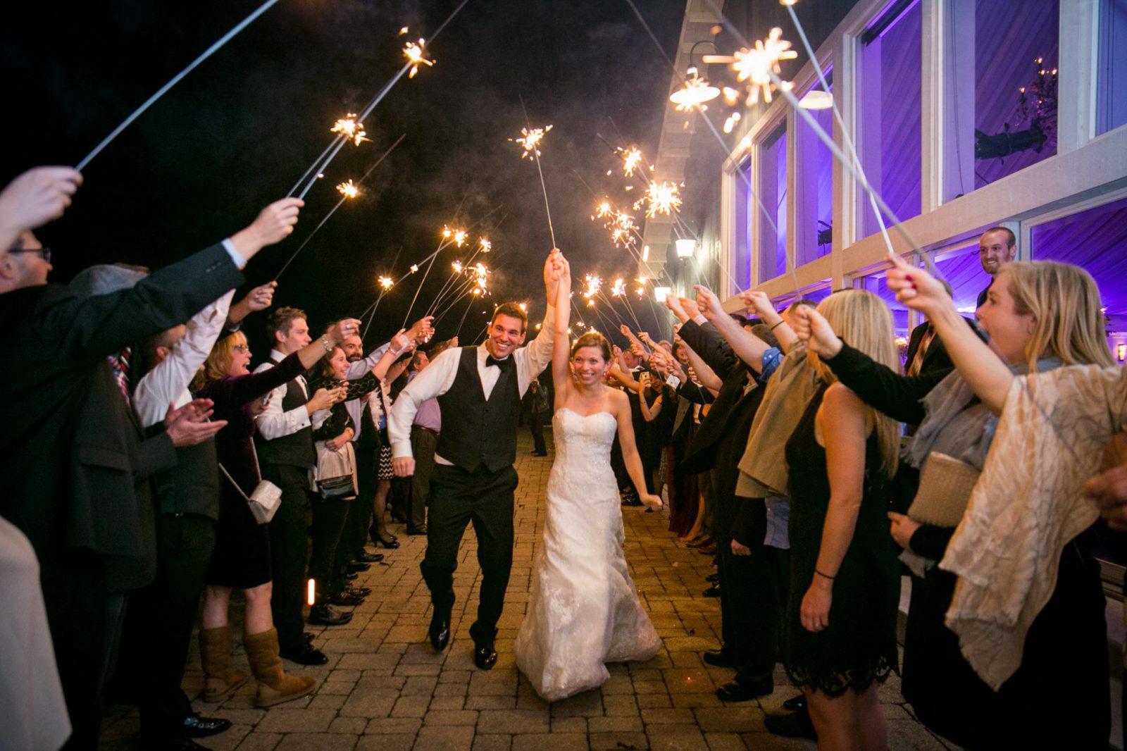 Sparkler sendoff at lakeside wedding at The Lakehouse Inn