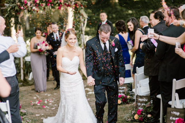 Bride and groom confetti toss at Pomme Wedding