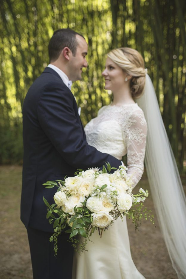 Bride with ivory bouquet and groom outside Old Mill wedding