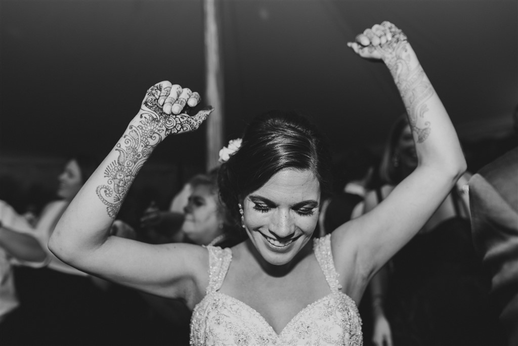 dancing bride with henna on hands at greenville country club wedding