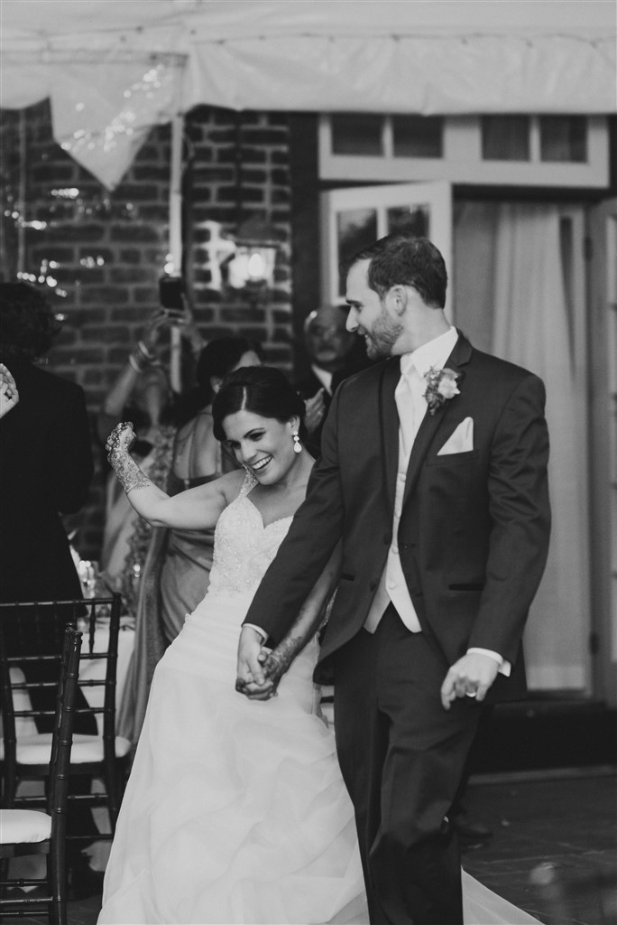 bride and groom enter reception at greenville country club wedding