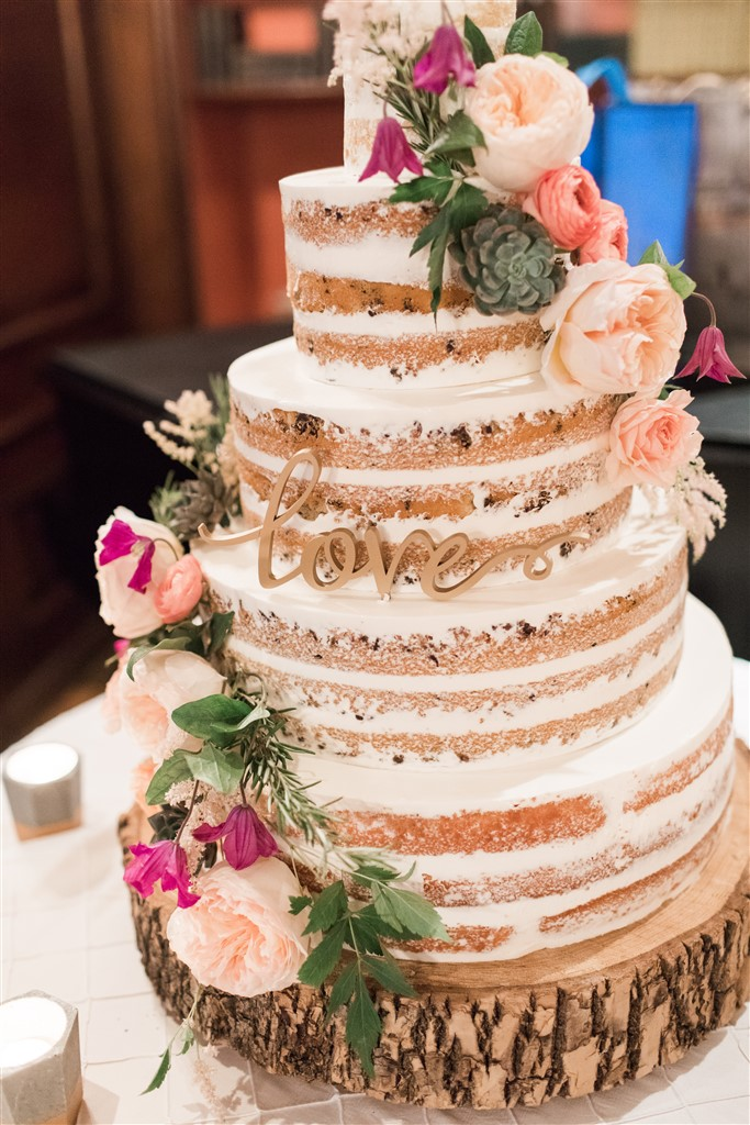 naked four tier cake with flowers by fresh designs florist