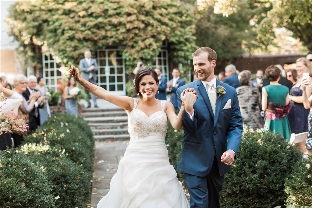bride and groom just married at greenville country club