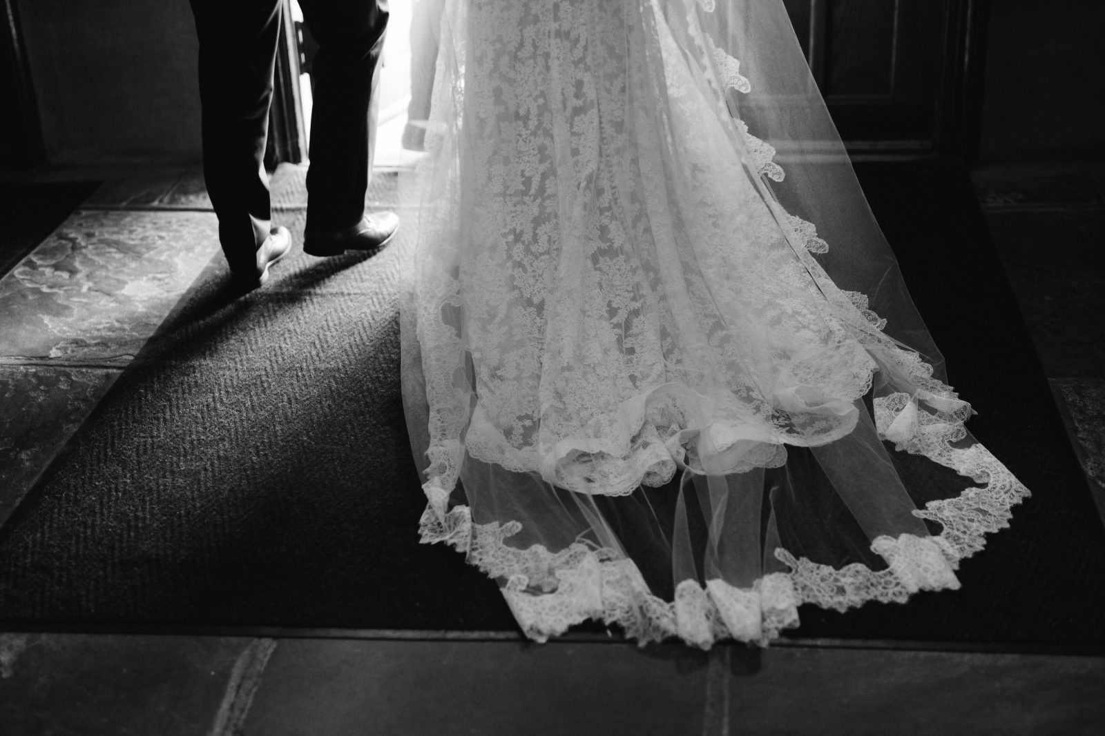 Back of brides lace-trimmed cathedral veil over lace dress at Ridgeland Mansion Philadelphia Wedding. Photo by Ali & Paul Co
