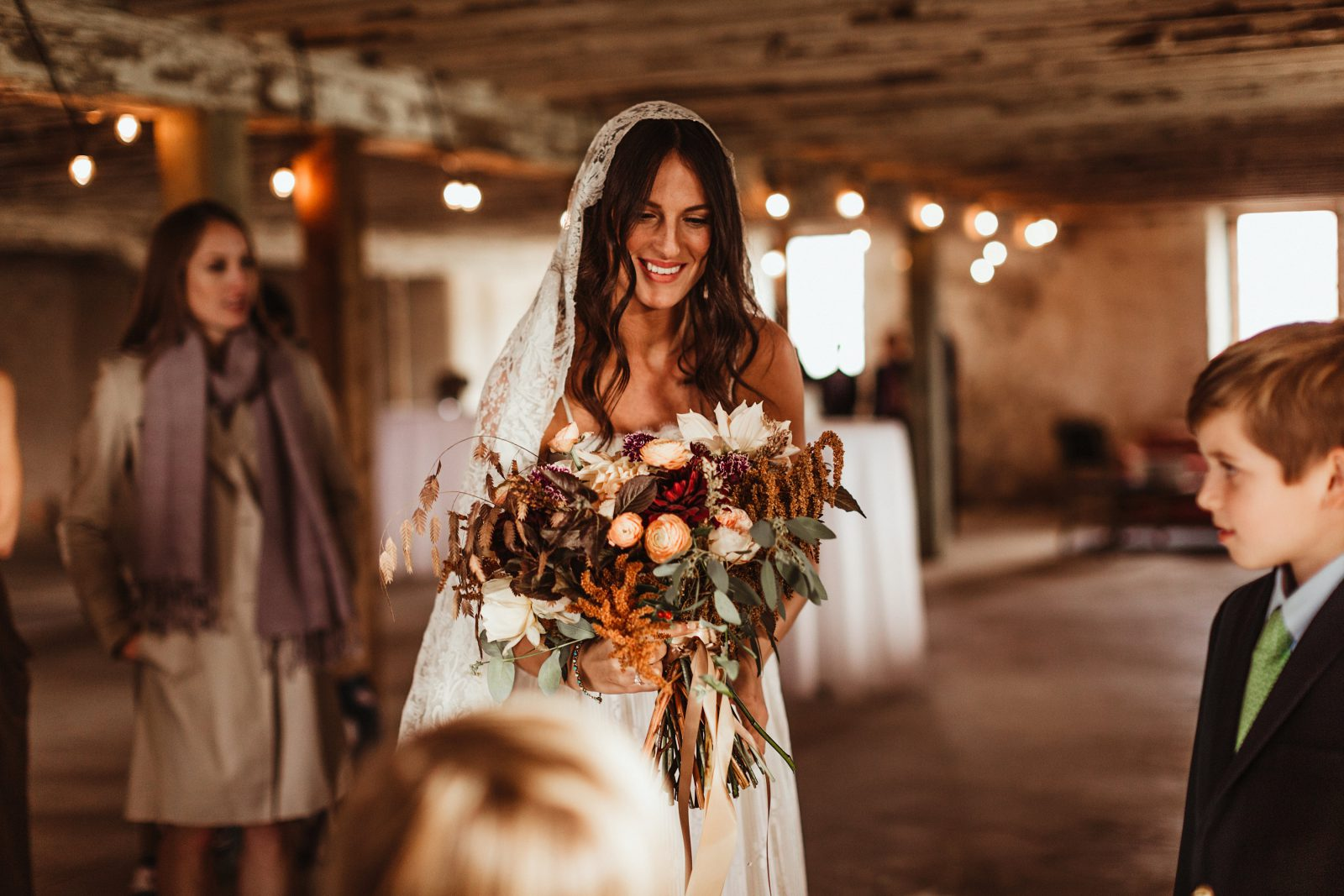 boho bride with rustic bouquet during wedding at historic penn farm