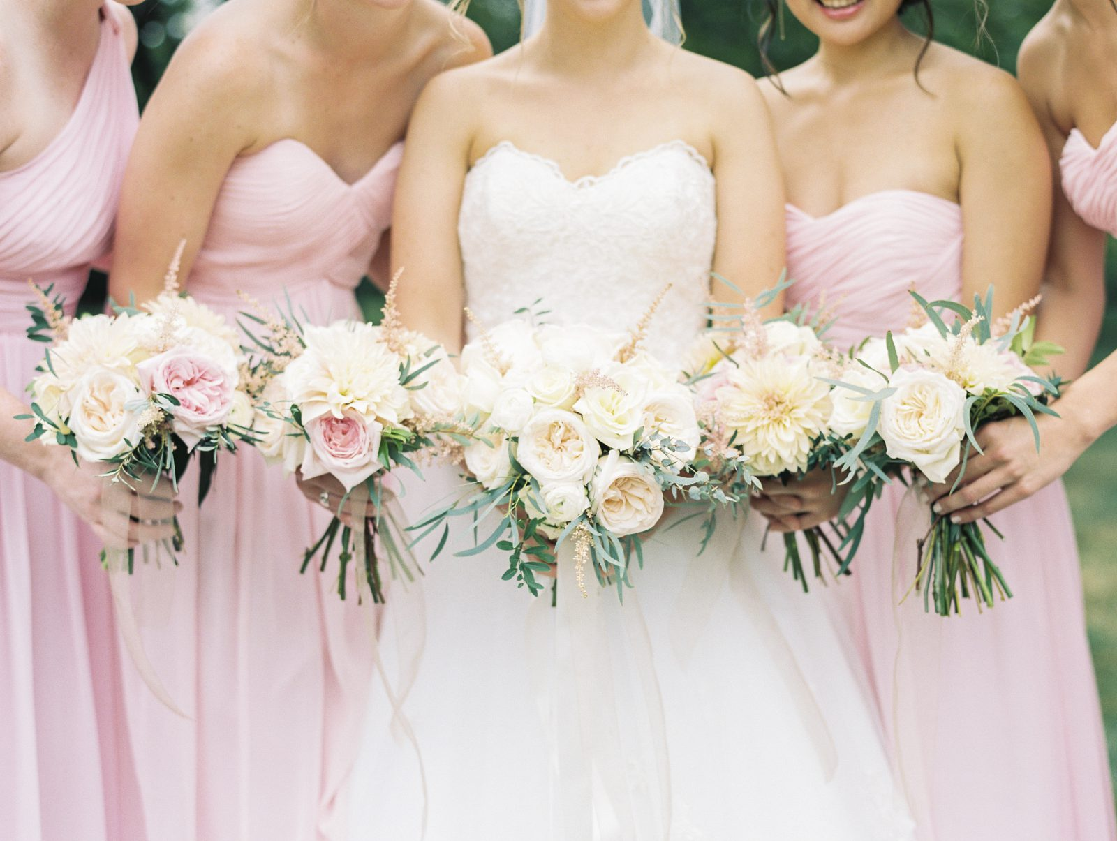 bride and bridesmaids carrying blush garden rose bouquets by fresh designs florist at duportail house wedding near philadelphia
