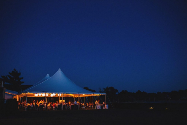 Nighttime tented wedding at Riverside Yacht Club