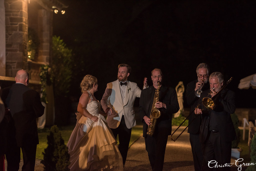 Bride and Groom exit Greystone Hall Wedding reception escorted by Janis Nowlan Band's horn section. Photo by Christie Green Photography
