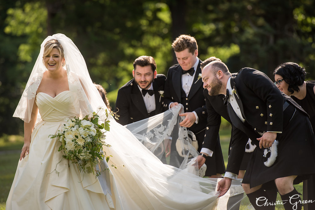 Classic bride in Modern Trouseau with her best men in kilts at Greystone Hall Wedding. Photo by Christie Green Photography