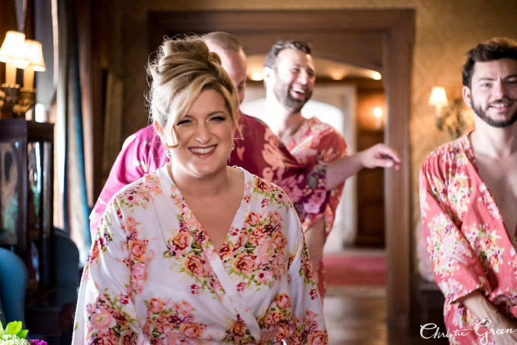 Bride and her best men in silk floral robes getting ready for Greystone Hall wedding. Photo by Christie Green Photography