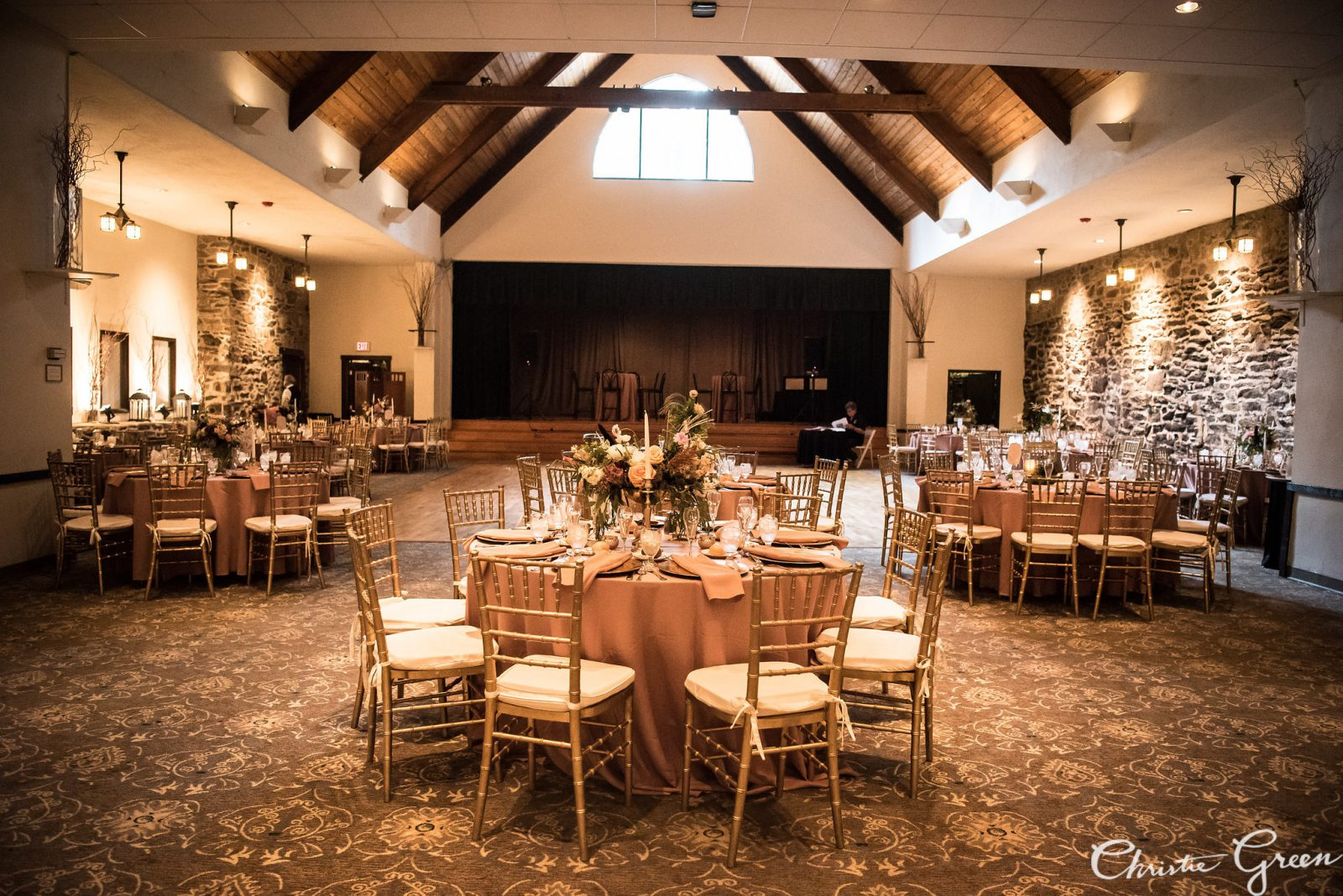 Round tables in blush linens and gold chiavari chairs set for wedding reception in the Ballroom at The Old Mill. Flowers by Fresh Designs Florist. Photo by Christie Green Photography