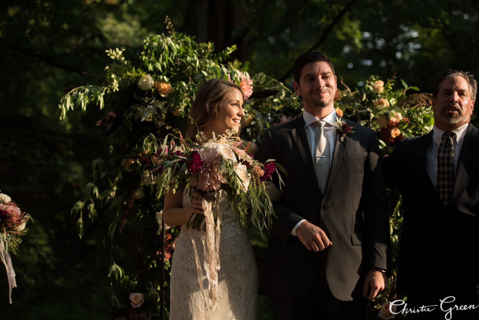 Bride and groom at The Old Mill Wedding Ceremony. Lush Garden Bouquet by Fresh Designs Florist. Photo by Christie Green Photography