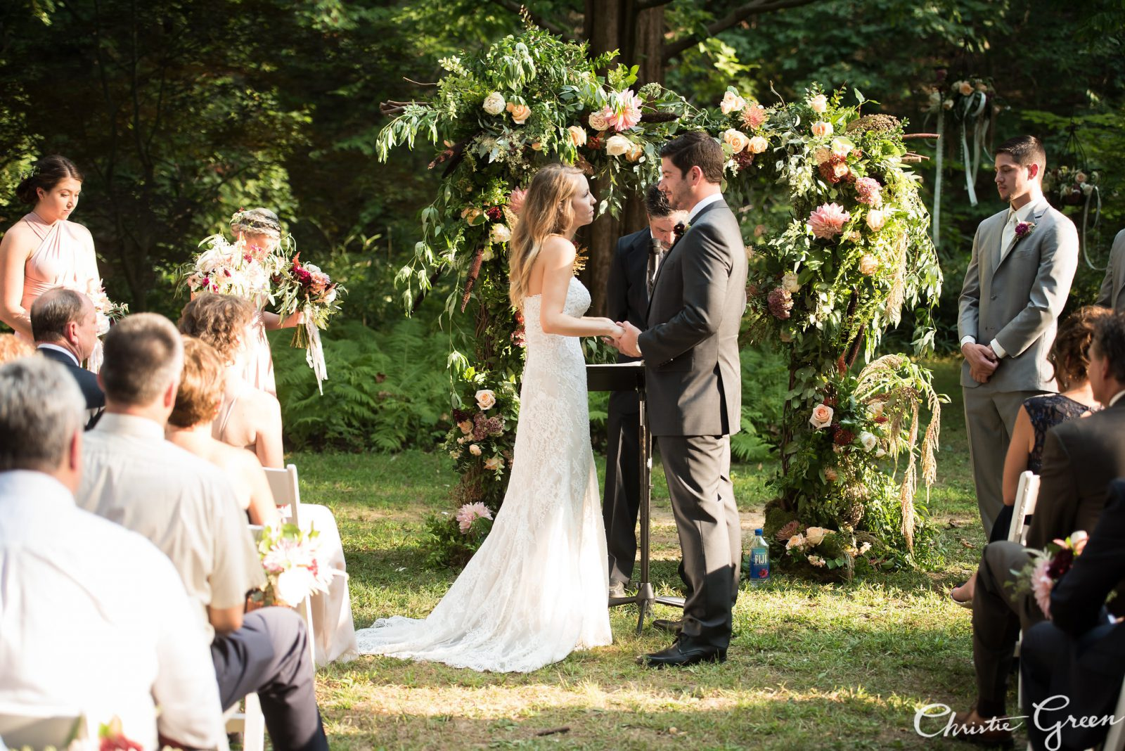 Outdoor Summer Wedding at The Old Mill with Lush Flower Arch