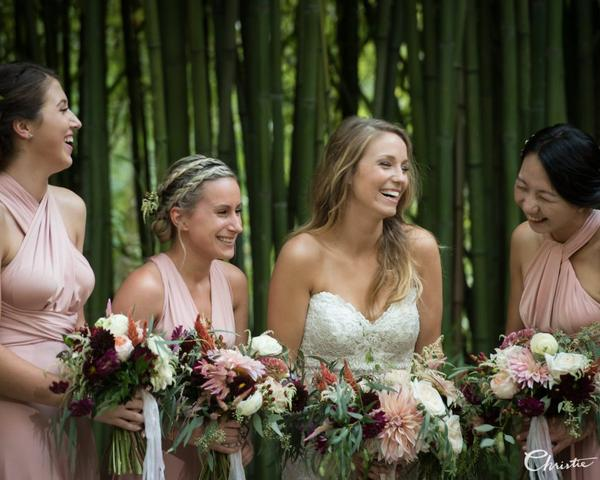 Bride in Justin Alexander and Bridesmaids in Blush holding Summer Garden Bouquets by Fresh Designs Florist at The Old Mill