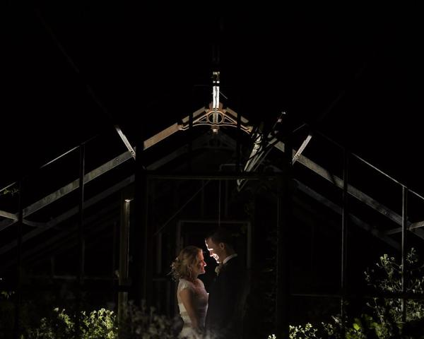 Bride and Groom Nighttime Portrait with back lighting at Philander Chase Knox Estate by Christie Green Photography