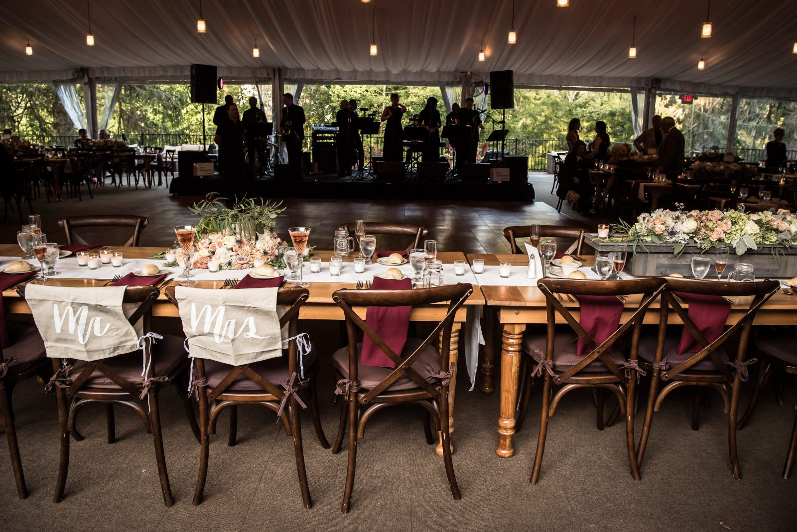 Philander Chase Knox Estate tented wedding reception, featuring long farmhouse tables and blush florals. Photo by Christie Green Photography
