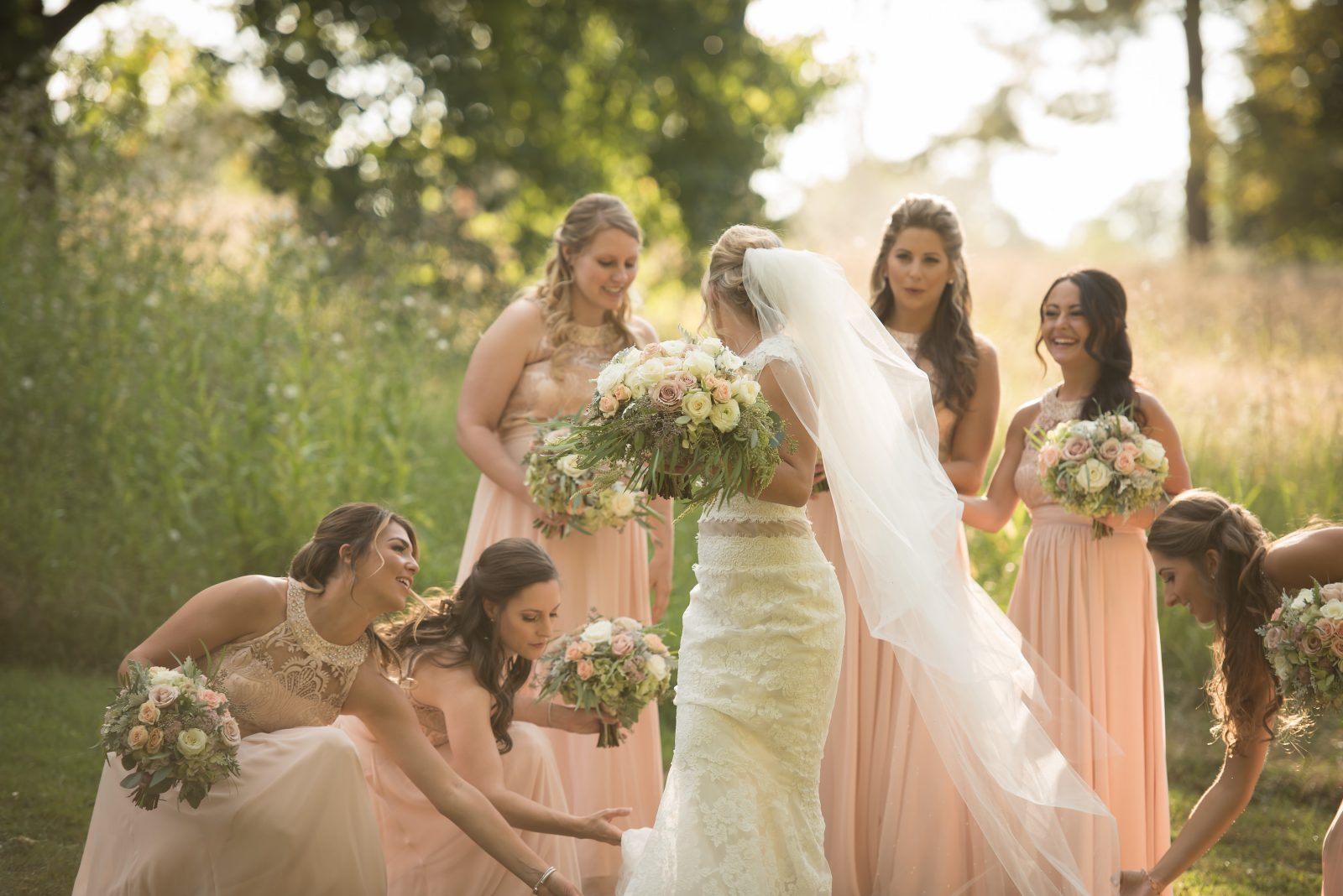 Bridesmaids in blush tend to the bride at Philander Chase Knox Estate Wedding. Photo by Christie Green Photography