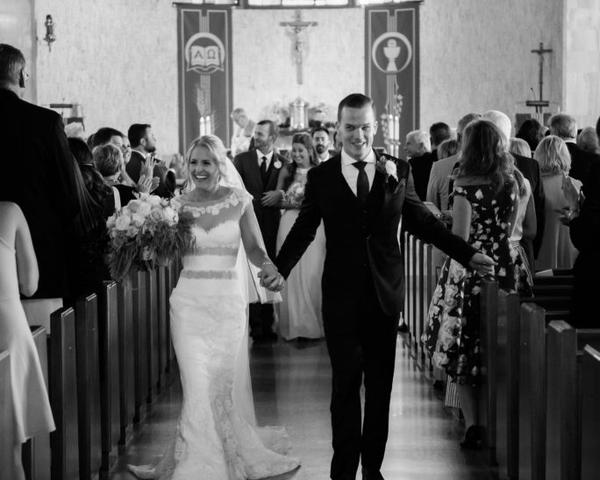 Bride and groom exit Our Lady of the Rosary Church before Philander Chase Knox Estate wedding reception. Photo by Christie Green Photography