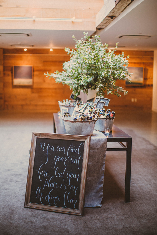 You can find your seat here but your place is on the dance floor. Wedding chalkboard sign by La Luna by Sierra. Photo by Forged in the North