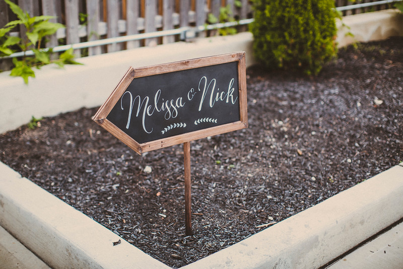 Chalkboard wedding sign arrow by La Luna by Sierra. Photo by Forged in the North