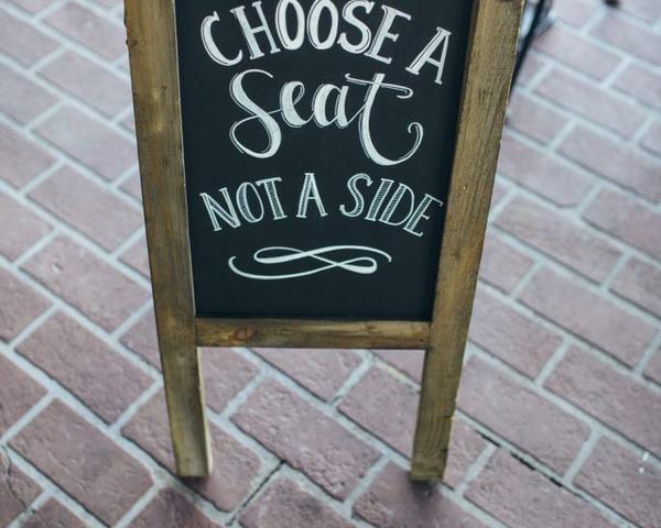 Choose a seat not a side wedding chalkboard sign by La Luna by Sierra. Photo by Christian Gideon Photography