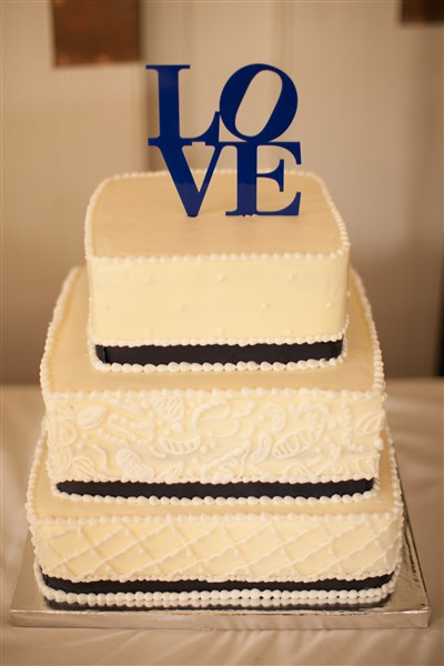 Classic square white buttercream wedding cake with navy accents topped with Philly Love by Country Butcher. Photo by Amy Tucker Photography