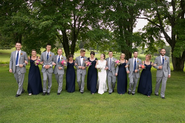 Bridal party in full force at Loch Nairn Golf Club Wedding. Bride in Maggie Sottero, bridesmaids in navy Bill Levkoff, groom and groomsmen in grey suits. Photo by Amy Tucker Photography