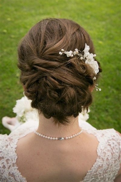 Close up of bride's hair by Brooke at Fedora Salon. Photo by Amy Tucker Photography