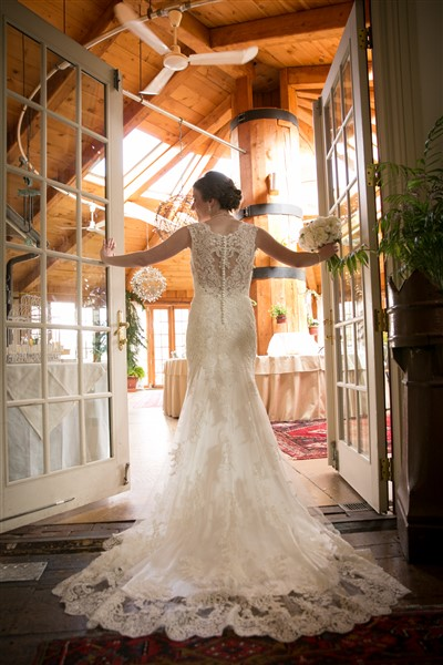 Back of an elegant lace Maggie Sottero gown as bride enters the Great House at Loch Nairn Golf Club Wedding