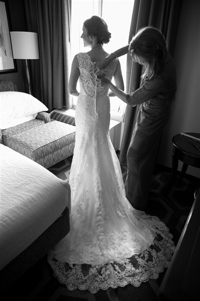 Back of an elegant lace Maggie Sottero gown as bride gets ready at Loch Nairn Golf Club. Photo by Amy Tucker Photography