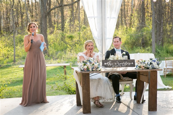 Maid of honor delivers speech next to rustic sweetheart table at Anthony Wayne House Wedding reception. Photo by Amy Tucker Photography