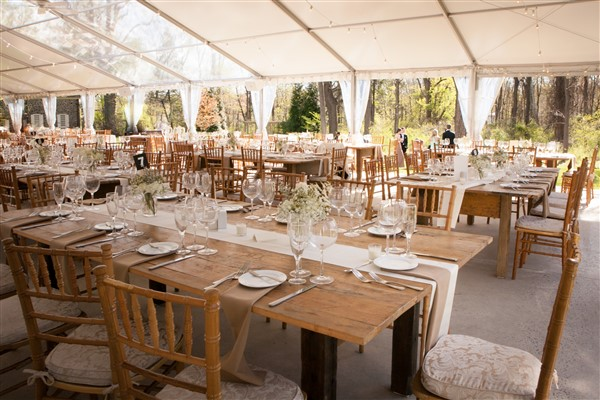 Rustic tented reception at Anthony Wayne House Wedding with long farm tables and chiavari chairs. Photo by Amy Tucker Photography