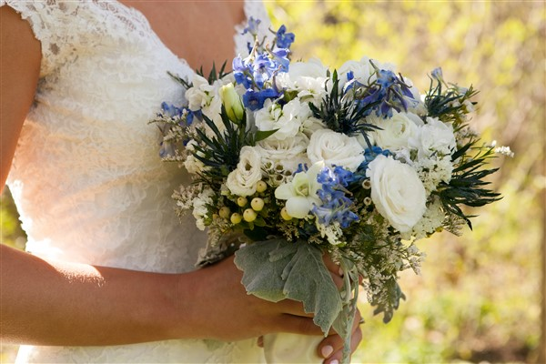 Spring garden bridal bouquet with white and blue florals by Alfred of Philadelphia. Photo by Amy Tucker Photography