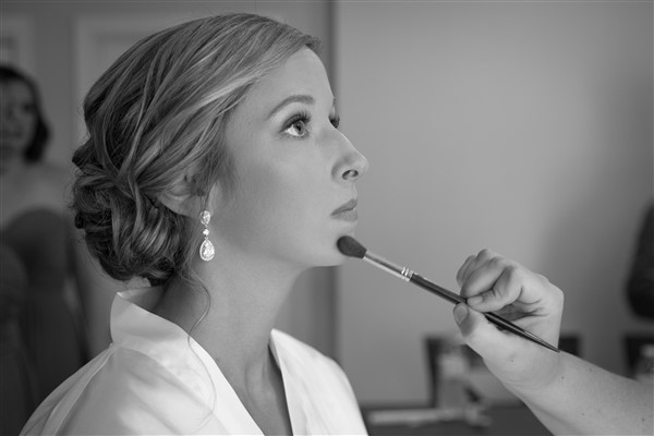 Finishing touches on natural bridal makeup by Tara Quinn Beauty for Anthony Wayne House bride. Photo by Amy Tucker Photography