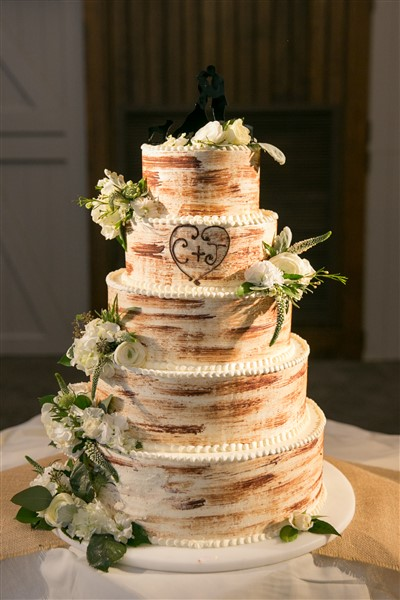 Rustic five-tier wedding cake by Normandy Farm Hotel with fresh flowers by Enchanted Florist