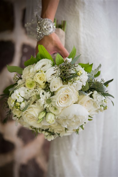 All white bridal bouquet by Enchanted Florist. Photo by Amy Tucker Photography
