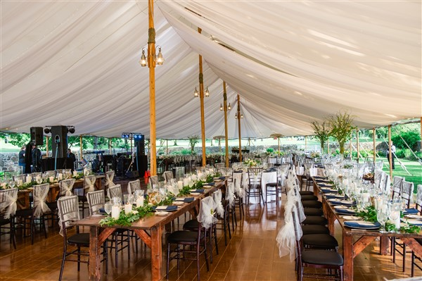Tented reception at Saucon Valley Country Club with long Barnes Farm Tables. Photo by Alexandra Whitney Living