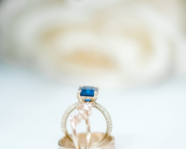 Gold wedding bands and sapphire engagement ring