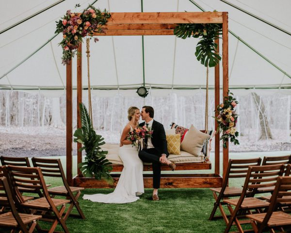 Bride and Groom on Wooden Swing by Borrow Curated