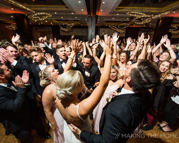 Bride and Groom Dancing in a crowd of wedding guests